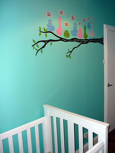 Stickers or decals can add charm to a plain wall.