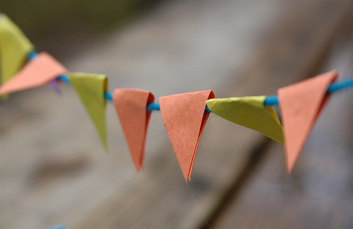 Mini bunting made from scraps of paper and cotton.