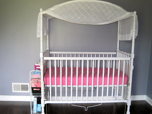 Pretty drapes add a special something to an ordinary cot.