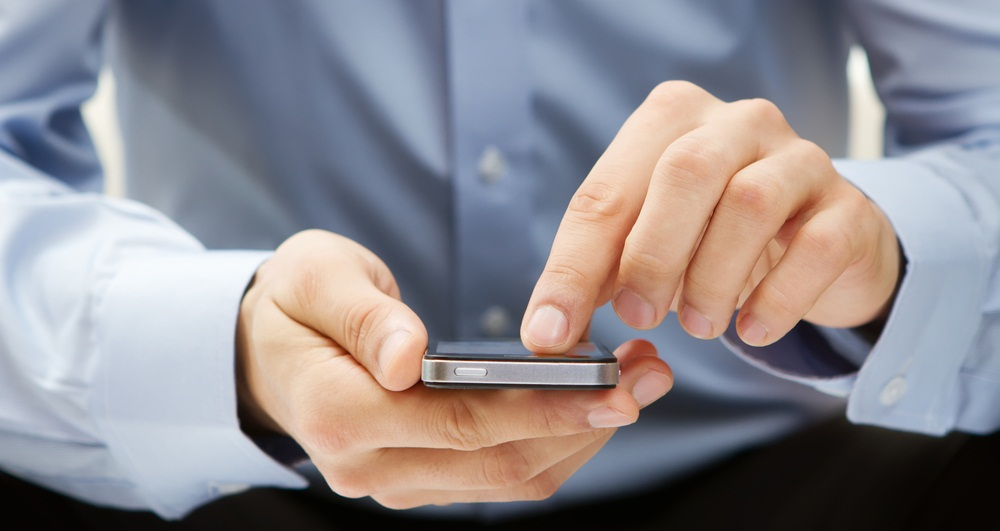 A businessman use a phone.